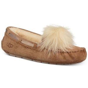 UGG® Womens Dakota Moccasin Pom Pom Slippers